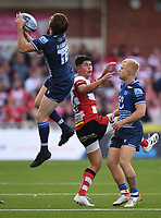 9th October 2021; Kingsholm Stadium, Gloucester, England; Gallagher Premiership Rugby, Gloucester versus Sale Sharks;  Simon Hammersley of Sale Sharks catches a high kick under pressure from Louis Rees-Zammit of Gloucester