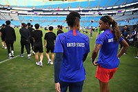 CHARLOTTE, NC - OCTOBER 03: Adrianna Franch #21 and Jessica McDonald #22 of the United States chat prior to their game versus Korea Republic at Bank of American Stadium, on October 03, 2019 in Charlotte, NC.