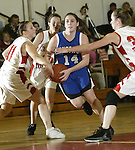 LITCHFIELD, CT, 01/03/08- 010308BZ06- Shepaug's Stephanie Moots (14) drives through the defense of Wamogo's Nikkie Sidall (11) Megan Murray (12) and Jen Sadowski (32) during their game at Wamogo High School in Litchfield Thursday night.<br /> Jamison C. Bazinet Republican-American