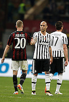 Calcio, Serie A: Milan vs Juventus. Milano, stadio San Siro, 9 aprile 2016. <br /> Milan's Ignazio Abate, left, greets Juventus's Simone Zaza at the end of the Italian Serie A football match between AC Milan and Juventus at Milan's San Siro stadium, 9 April 2016. Juventus won 2-1.<br /> UPDATE IMAGES PRESS/Isabella Bonotto