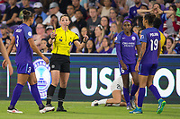 Orlando, FL - Saturday March 24, 2018: The referee warns the Orlando Pride players during a regular season National Women's Soccer League (NWSL) match between the Orlando Pride and the Utah Royals FC at Orlando City Stadium. The game ended in a 1-1 draw.