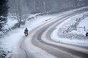 29/01/19<br /> <br /> A young lady motorcyclist slithers along a lane near Mensal Head, Bakewell, Derbyshire. She had already crashed and smashed up her bike but she said she had no option than to carry on - she was planning to ride to Derby  (30 miles?). <br /> <br /> All Rights Reserved, F Stop Press Ltd +44 (0)7765 242650  www.fstoppress.com rod@fstoppress.com