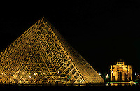 The Louvre Pyramid and the Arc de Triomphe du Carrousel at night, Paris, France.
