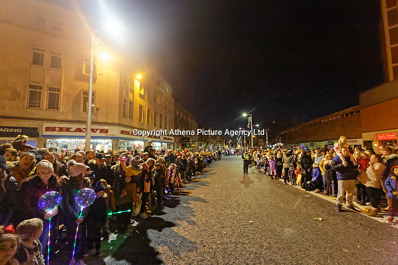 """Pictured: Locals line the Kingsway to watch the Christmas parade in Swansea, Wales, UK. Sunday 19 November 2018<br /> Re: Swansea Christmas parade attended by thousands has been branded a """"shambles"""" for having just three floats.<br /> The annual festive event in south Wales, which took place on Sunday, promised """"dynamic dance-troupes"""" as well as """"spectacular shows and stages"""".<br /> But the parade was scaled down, leading to a barrage of criticism on social media because of roadworks in the city centre. <br /> The leader of Swansea Council, Rob Stewart apologised on Facebook and said the parade was not """"good enough"""".<br /> Parents took on social media to voice their anger, calling the event """"a load of rubbish"""" and claiming there was nothing for young children apart from """"a loud music float with Santa on""""."""