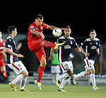Lee McCulloch blooters the ball into the night sky