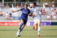 CARY, NC - SEPTEMBER 12: Meredith Speck #25 of the North Carolina Courage is challenged for the ball by Morgan Weaver #22 of the Portland Thorns FC during a game between Portland Thorns FC and North Carolina Courage at Sahlen's Stadium at WakeMed Soccer Park on September 12, 2021 in Cary, North Carolina.
