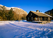 Scenic view from Lafayette Place in Franconia Notch, New Hampshire during the winter months. Cannon Mountain is in the background. The Franconia Notch Bike Path travels pass this cabin.