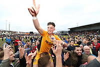 Tom Owen-Evans of Newport County celebrates with fans during a pitch invasion after the final whistle as a late goal from Mark O'Brien secures safety for Newport to stay in League two during the Sky Bet League Two match between Newport County and Notts County at Rodney Parade, Newport, Wales, UK. Saturday 06 May 2017