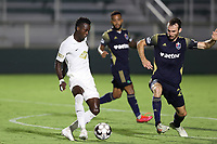 CARY, NC - AUGUST 01: Rudolf Mensah #14 is defended by Conor Donovan #20 during a game between Birmingham Legion FC and North Carolina FC at Sahlen's Stadium at WakeMed Soccer Park on August 01, 2020 in Cary, North Carolina.