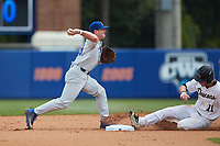 Deacon Liput (8) of the Florida Gators makes a throw to first base as Jonathan Pryor (11) of the Wake Forest Demon Deacons slides into second base in Game Two of the Gainesville Super Regional of the 2017 College World Series at Alfred McKethan Stadium at Perry Field on June 11, 2017 in Gainesville, Florida.  (Brian Westerholt/Four Seam Images)