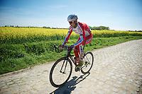 A lone Kutusha rider over the cobbles<br /> <br /> 2014 Paris - Roubaix reconnaissance