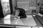Patrick Hughes artist in his London studio, 43 Idmiston Road, London SE27 1968 UK.Painting thats is being worked on destroyed.<br /> <br /> In background 'Three Doors', 1965