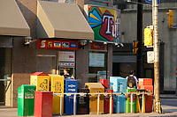 Colorful Newpapers boxes on..Carlton street , east of Yonge in Toronto