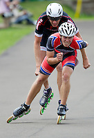 11 AUG 2013 - BIRMINGHAM, GBR - James Ashby (left)  of Wisbech Inline Speed Skating Club leads Sutton Atkins (right) of East Midlands Racing in the Senior Men's 10,000m Points final during the Federation of Inline Speed Skating 2013 British Outdoor Championships at Birmingham Wheels Park in Birmingham, West Midlands, Great Britain (PHOTO COPYRIGHT © 2013 NIGEL FARROW, ALL RIGHTS RESERVED)