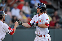 First baseman Jantzen Witte (35) of the Greenville Drive is congratulated after scoring a run in a game against the Greensboro Grasshoppers on Wednesday, May 7, 2014, at Fluor Field at the West End in Greenville, South Carolina. Greenville won, 12-8. (Tom Priddy/Four Seam Images)