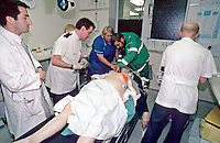 Doctors and nurses attending to a cardiac arrest patient in the crash room of an accident and emergency department of a hospital. The paramedic is helping to intubate the victim...© SHOUT. THIS PICTURE MUST ONLY BE USED TO ILLUSTRATE THE EMERGENCY SERVICES IN A POSITIVE MANNER. CONTACT JOHN CALLAN. Exact date unknown.john@shoutpictures.com.www.shoutpictures.com..