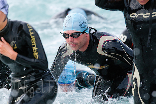 24 APR 2011 - NICE, FRA - Competitors race from the water during the Triathlon de Nice Cote d'Azur (PHOTO (C) NIGEL FARROW)