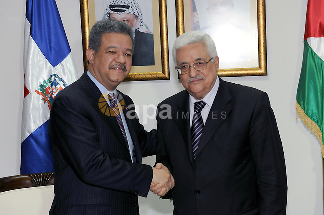 Palestinian President Mahmoud Abbas (Abu Mazen) shakes hands with his Dominican counterpart Leonel Fernandez during a meeting in the West Bank city of Ramallah on June 19, 2011.  Photo by Thaer Ganaim
