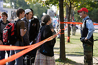 Montreal (Qc) CANADA - Sept 24 2008 File Photo-<br /> Montreal city Policemen, currently  protesting labour dispute by wearing non-official clothing such as paramilitary camouflage pants, blue jeans, red cap, ...<br /> intervene at AHUNTSIC COLLEGE on the scene of an alleged street gang related shooting.