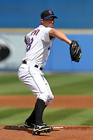 New York Mets Chris Capuano #38 delivers a pitch during an exhibition game vs the Michigan Wolverines at Digital Domain Ballpark in Port St. Lucie, Florida;  February 27, 2011.  New York defeated Michigan 7-1.  Photo By Mike Janes/Four Seam Images