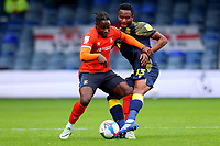 17th October 2020; Kenilworth Road, Luton, Bedfordshire, England; English Football League Championship Football, Luton Town versus Stoke City; Mikel John Obi of Stoke City challenges Pelly Ruddock of Luton Town