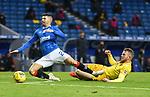25.10.2020 Rangers v Livingston: Nicky Devlin puts a last ditch tackle in on Jordan Jones