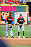 Kansas City Royals Salvador Perez and Seattle Mariners Felix Hernandez joke during practice before the MLB All-Star Game on July 14, 2015 at Great American Ball Park in Cincinnati, Ohio.  (Mike Janes/Four Seam Images)