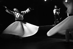 """Raqib Brian Burke, left, and Jane Garland whirl to the poetry of Mevlana Jalaluddin Rumi, while celebrating the Sufi spiritual leader's 800th birthday at the ArtsCenter in Carrboro.  """"Whirling is a form of prayer,"""" explains Garland, """"a way of connecting to the divine.  As you become a human prayer wheel, the right hand receives, and the left hand transmits.  You become like a channel of energy so that the divine energy can come through and express itself."""""""
