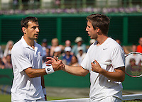 29-06-13, England, London,  AELTC, Wimbledon, Tennis, Wimbledon 2013, Day six, Igor Sijsling (NED) gives up the match and congratulates Ivan Dodig (CRO)left.<br /> <br /> <br /> <br /> Photo: Henk Koster