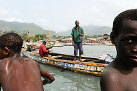 SIERRA LEONE fishing harbour Tombo, food security and the livelyhood of small fishermen are affected by international big trawler fleet / SIERRA LEONE Fischerhafen Tombo, die Ernaehrungssicherung der Kuestenbewohner und die Existenz von Kuestenfischern ist durch Ueberfischung grosser Trawler Flotten bedroht, Sohn eines Fischers