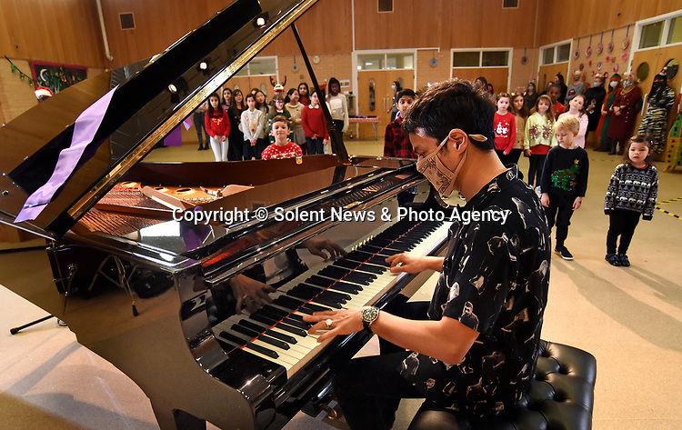 School pupils were stunned when singer Jamie Cullen turned up and gave them his treasured grand piano.  The jazz musician delivered his own piano to children at Frith Manor Primary School in Woodside Park, North London, after he was bowled over by a song they wrote called 'We love the piano'.<br /> <br /> The priceless Yamaha S6 Grand Piano will now take pride of place in the school's main hall and will be used for concerts, assemblies, and piano lessons.  Children at the school had entered their song in a competition run by Yamaha and judged by Cullum, who selected it as the winner for 'showcasing outstanding originality, captivating lyrics, and a cheerful melody'.  SEE OUR COPY FOR DETAILS.<br /> <br /> © Solent News & Photo Agency<br /> UK +44 (0) 2380 458800