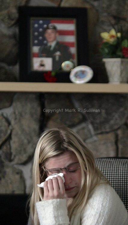 Family & friends of  U.S. Army Spc. Steven R. Koch gather in his mother's home along Garden Terrace in Milltown. Koch was killed in Afghanistan on March 3rd.  Koch's sister Lynne, age 27 wipes tears from her eyes as she speaks about her brother. A photo of Steven is above Lynne on the mantle of the family's fireplace.<br /> METRO<br /> 0849<br /> ON THUR MARCH 6,2008<br /> MARK R. SULLIVAN/CHIEF PHOTOGRAPHER