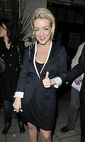 "SHERIDAN SMITH .Departed after the first preview performance of ""Flare Path"", Haymarket, London, England, UK, 4th March 2011..half length black dress white sleeves trim shoes coat hand thumb up gesture  jacket blazer dress .CAP/CAN.©Can Nguyen/Capital Pictures."