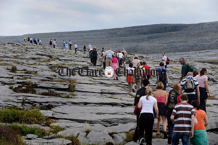 Participants travel up the limestone pavement in the Caher Valley during the Burren Ramble, held in aid of the Lifeboats. Photograph by John Kelly.