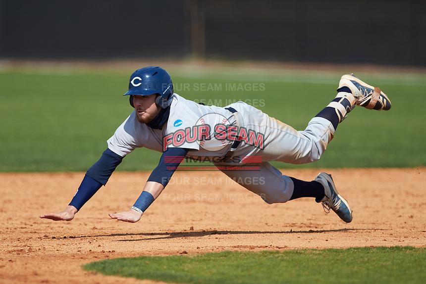 Jeremy Simpson (3) of the Catawba Indians dives head first into second base during game two of a double-header against the Queens Royals at Tuckaseegee Dream Fields on March 26, 2021 in Kannapolis, North Carolina. (Brian Westerholt/Four Seam Images)