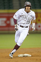 Texas A&M Aggie outfielder Daniel Mengden #15 rounds second base against the against the Houston Cougars in the NCAA baseball game on March 1st, 2013 at Minute Maid Park in Houston, Texas. Houston defeated Texas A&M 7-6. (Andrew Woolley/Four Seam Images).