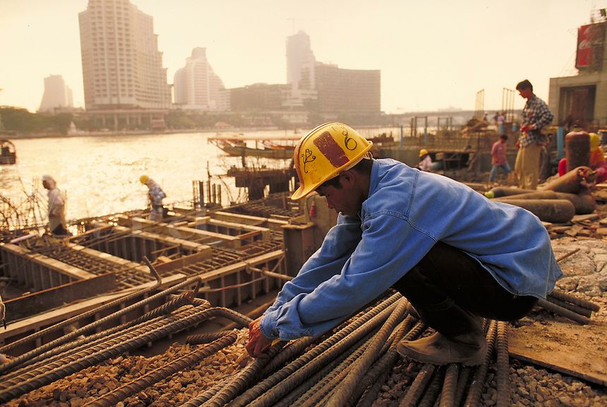 The Peninsula. The last of the mid 90's construction boom in Bangkok, Thailand. Close up of laborer working with rebar. Bangkok, Thailand.