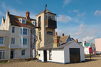 Brightly colored painted houses and fisherman's lookout tower on the sea front beach at Aldeburgh, East Anglia, Suffolk, England