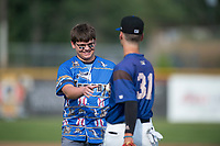 A Missoula Osprey fan meets Blaze Alexander (31) after throwing out the first pitch before a Pioneer League game between the Missoula Osprey and the Orem Owlz at Ogren Park Allegiance Field on August 19, 2018 in Missoula, Montana. The Missoula Osprey defeated the Orem Owlz by a score of 8-0. (Zachary Lucy/Four Seam Images)