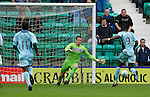 Hibs v St Johnstone...25.08.12   SPL.Ben Williams blocks Gregory Tade as he is through on goal.Picture by Graeme Hart..Copyright Perthshire Picture Agency.Tel: 01738 623350  Mobile: 07990 594431
