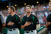 Dayton Dragons Ryan Campbell (left) and Jerry D'Andrea (right) during the national anthem before a Midwest League game against the Kane County Cougars on July 20, 2019 at Northwestern Medicine Field in Geneva, Illinois.  Dayton defeated Kane County 1-0.  (Mike Janes/Four Seam Images)
