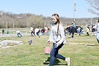 RACHEL DICKERSON/MCDONALD COUNTY PRESS McDonald County High School senior Kristen Penn participates in an Easter egg hunt held for seniors at the high school on April 1 in front of the school.