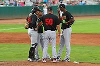 Dillon Haupt (20), Brian Drahman (50), Jairo Kelly (5) and Jose Brito (48) of the Great Falls Voyagers meet at the mound as the Voyagers faced the Ogden Raptors at Lindquist Field on August 16, 2013 in Ogden Utah.  (Stephen Smith/Four Seam Images)