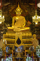 Bangkok, Thailand.  Buddha in the Ubosot of the Wat Arun Temple.  The Buddha displays the Bhumisparsha mudra (gesture), calling the earth to witness.