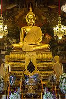 Bangkok, Thailand.  Buddha in the Ubosot of the Wat Arun Temple.  The Buddha displays the Bhumisparsha mudra (gesture), calling the earth to witness.