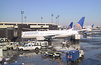 New York, Jan 22, 2001<br />  continental Airline Boeing 737 airplanes get ready for an international flight  at  Newark Airport (New Jersey, USA) Terminal C on January 22nd, 2001.<br /> As of Feb 3rd 2001, Continental is rumored to buy Delta Airlines in the near future.<br /> Photo by Pierre Roussel / Liaison<br /> NOTE :  RAW JPEG FROM CANON G 1