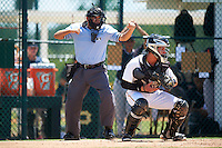 Umpire Josh Gilreath strike three call behind catcher Paul Brands (25) during a game between the GCL Yankees East and GCL Pirates on August 15, 2016 at the Pirate City in Bradenton, Florida.  GCL Pirates defeated GCL Yankees East 5-2.  (Mike Janes/Four Seam Images)