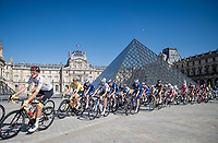 Entry of the peloton onto the Champs-Elysées circuit via the famous Louvre Museum Pyramid, with the team of yellow jersey / GC leader Tadej Pogacar (SVN/UAE-Emirates) leading the way.<br /> <br /> Stage 21 (Final) from Chatou to Paris - Champs-Élysées (108km)<br /> 108th Tour de France 2021 (2.UWT)<br /> <br /> ©kramon