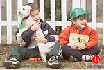 """CHESHIRE, CT 03/14/99 0314JH08.tif--Trevor Miller, 7, on left,  holds onto """"Bell,"""" a bichon born on last St. Patrick's Day, while his brother Kyle, 6, wears a green hat as they waited for the start of a St. Patrick's Day family fun run Sunday. JOHN HARVEY staff photo for Hartnett story."""