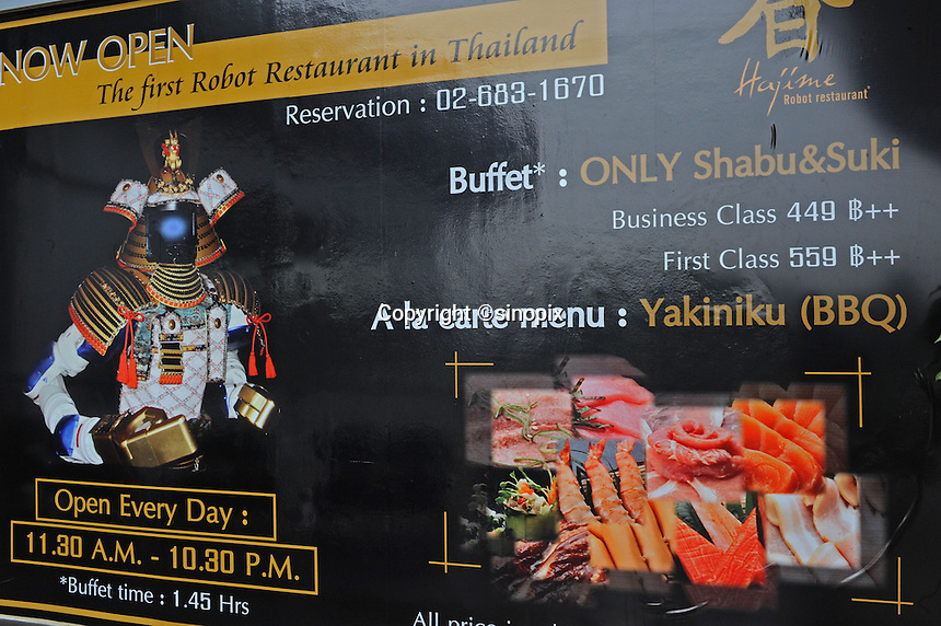 Advertising board of Hajime Restaurant states the price of buttet and menu, Bangkok, Thailand. Hajime is a Japanese restaurant in Thailand, has samurai style robot serving food to the diners and even do a dance session to entertain guests. This robot are made in Japan and costed about 86,600,000 yen (1,063,717USD). Customers order food in the Hajime Restaurant from touch panel and Samurai robot will bring ordered food to their table.<br />